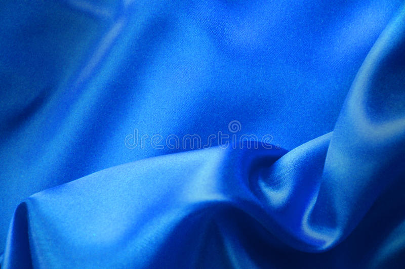 Glatte elegante blaue Seide kann als Hintergrund verwenden lizenzfreie stockfotografie