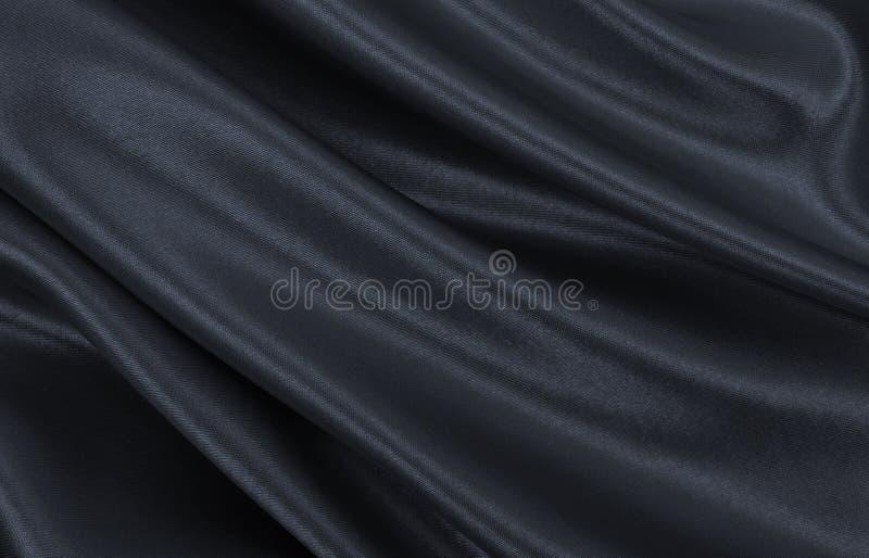 Glatte elegante dunkelgraue Seiden- oder Satinbeschaffenheit als abstraktes backg lizenzfreies stockbild