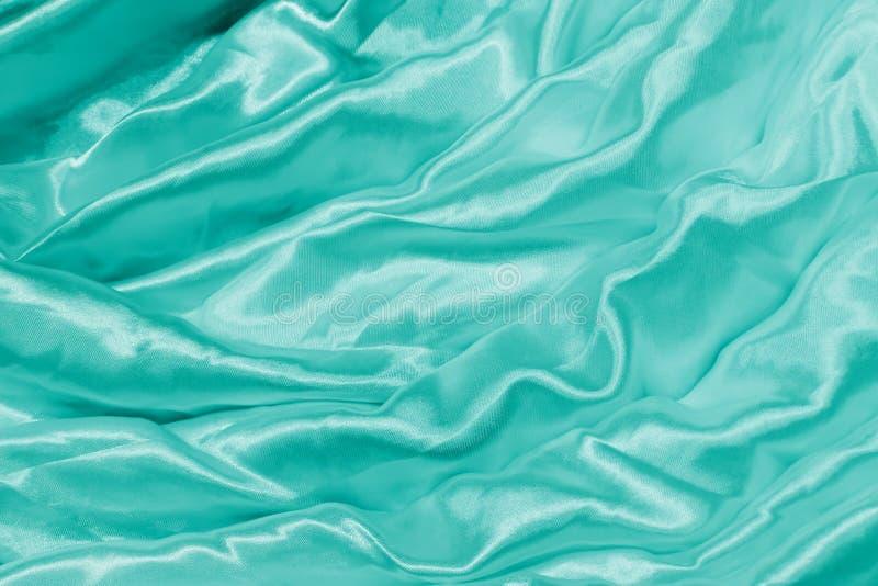 Glatte elegante grüne Seide stockbild