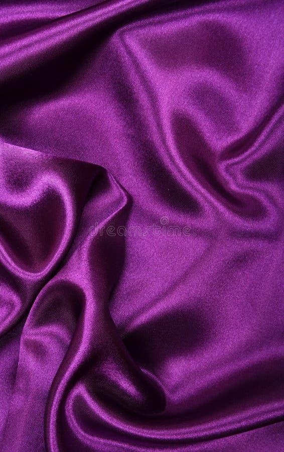 Glatte elegante lila Seide als Hintergrund stockbilder