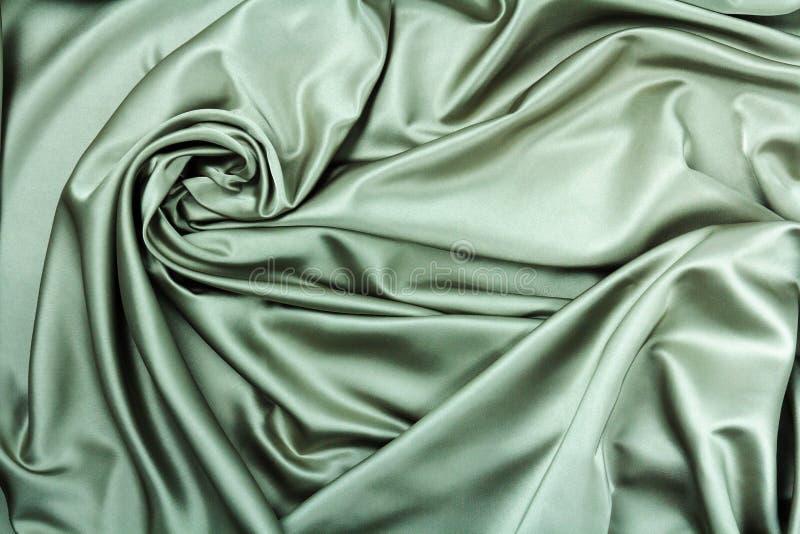 Glatte elegante Seiden- oder Satinluxusstoffbeschaffenheit kann als abstrakter Hintergrund verwenden stockfotos