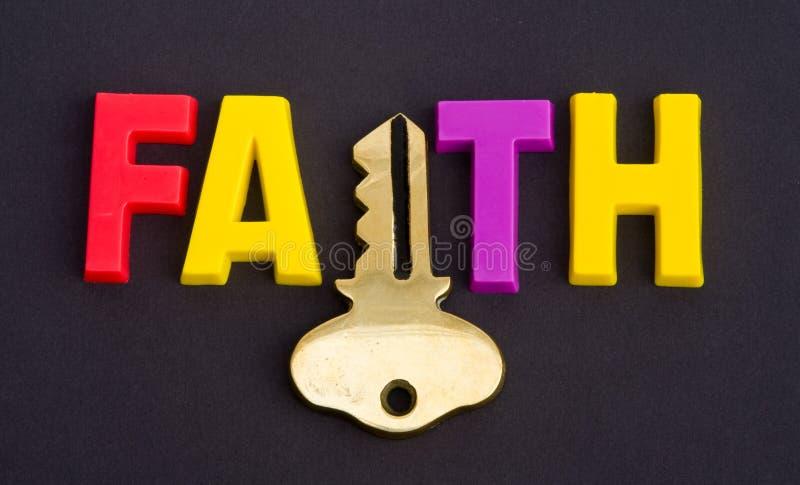 Glaube hält die Taste an. lizenzfreies stockfoto
