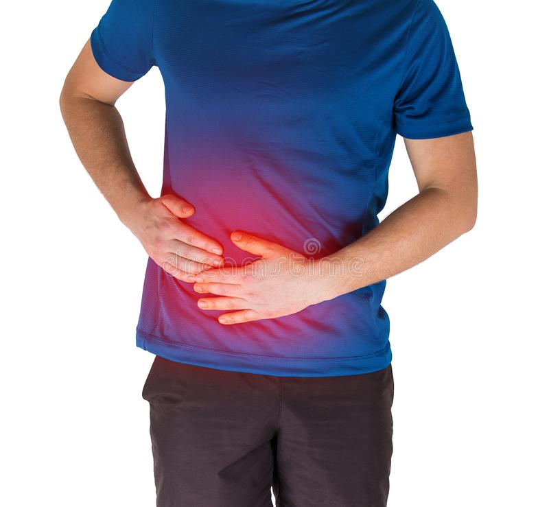 Glaubende Magenschmerzen und Seitenstechen des Athleten von der Übung lokalisiert über weißem Hintergrund stockbild