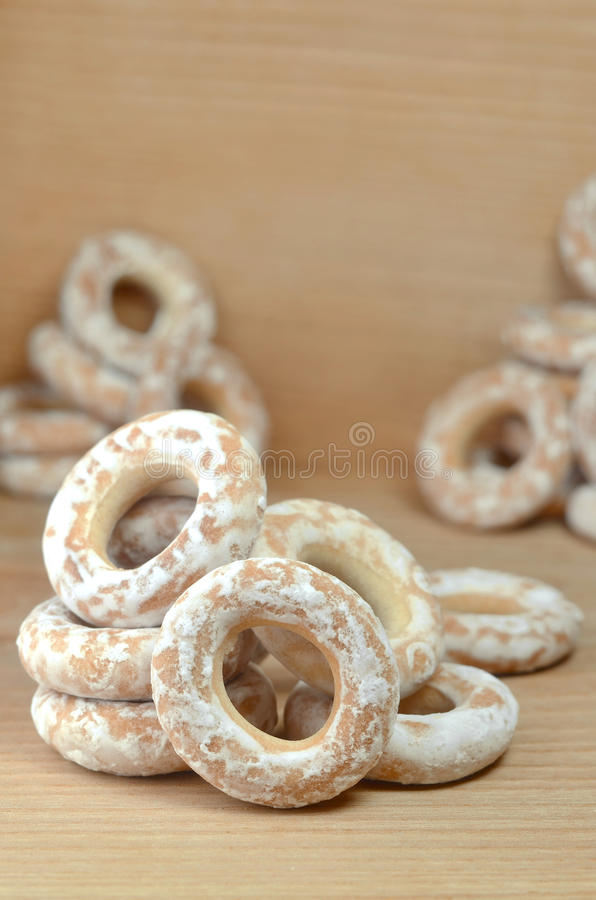 Glazed bagels on wooden table. Still life of donut glaze on a wooden surface. Glazed bagels are a small bunch on a wooden table. Flour sweets to the Tea Party royalty free stock photography