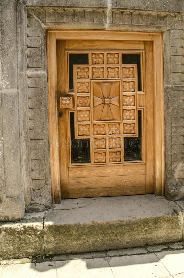 Glazed with carved wooden cross,low entrance door,for bowing the head in the churches of the monastery of Haghartsin,near the to stock images