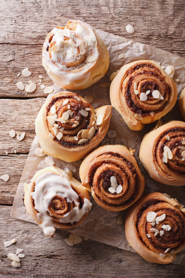 Free Glazed Cinnamon Rolls With Almond Close Up. Vertical Top View Stock Images - 65297984