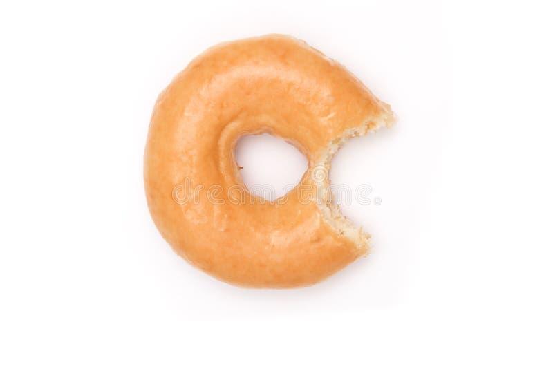 Glazed Donut with Bite on White background.  royalty free stock image