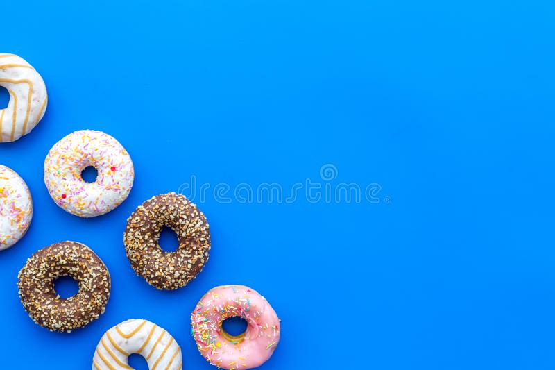 Glazed donut for dessert on blue background flat lay mock up royalty free stock photo
