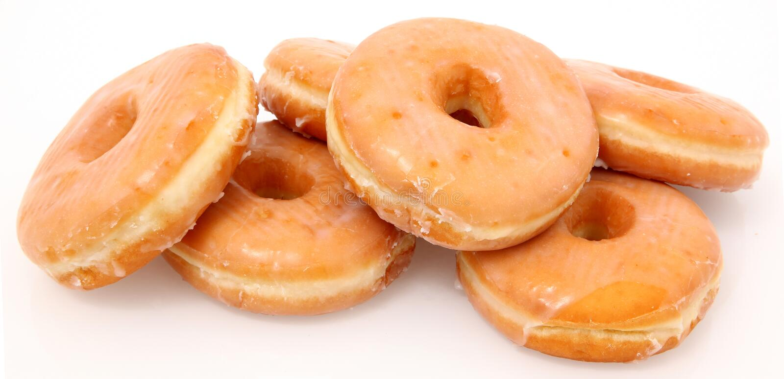 Glazed Donuts. Shot on white. (shot as is, not an isolation stock photo