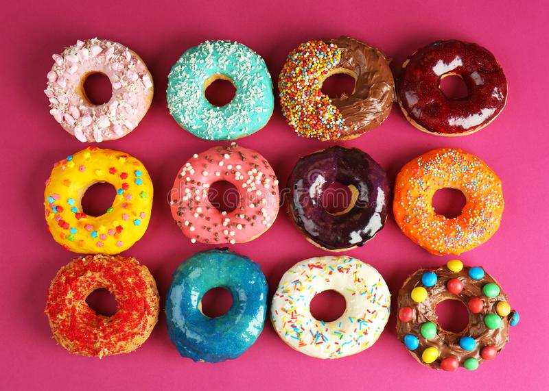 Glazed donuts. On color background royalty free stock photo
