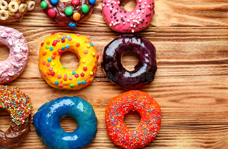 Glazed donuts. On wooden background stock images