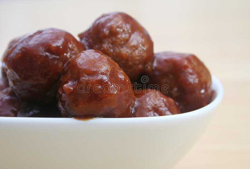 Glazed Meatballs. Close Up of Glazed Meatballs in white bowl stock photo