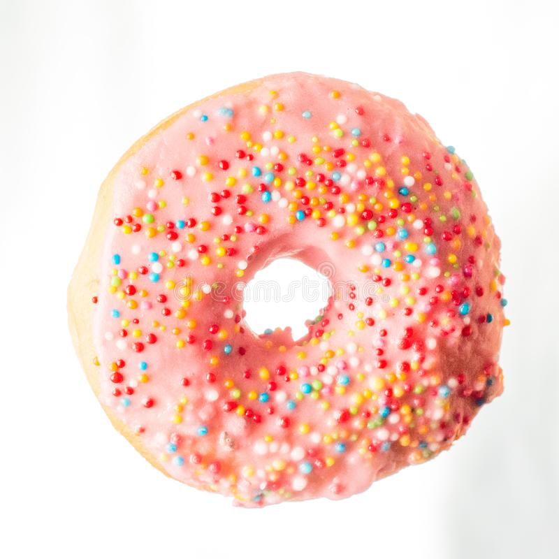 Free Glazed Pink Donut With Rainbow Sprinkles Royalty Free Stock Photography - 161014117
