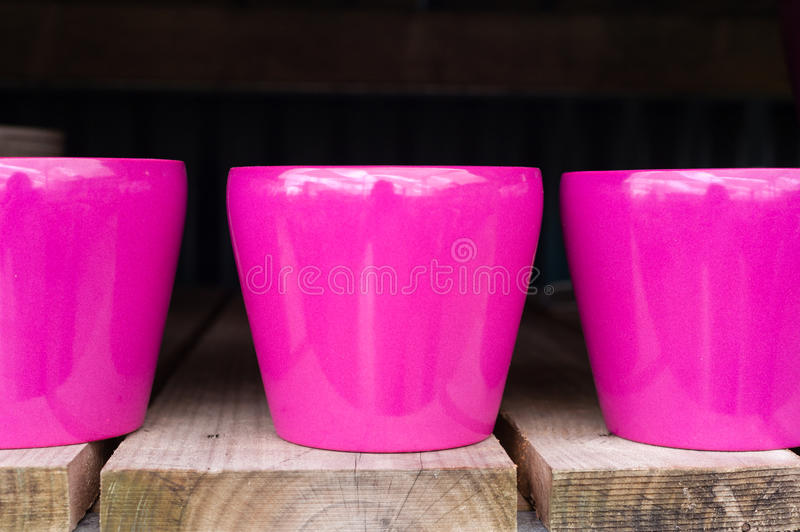 Glazed pink pots. At a garden centre royalty free stock images