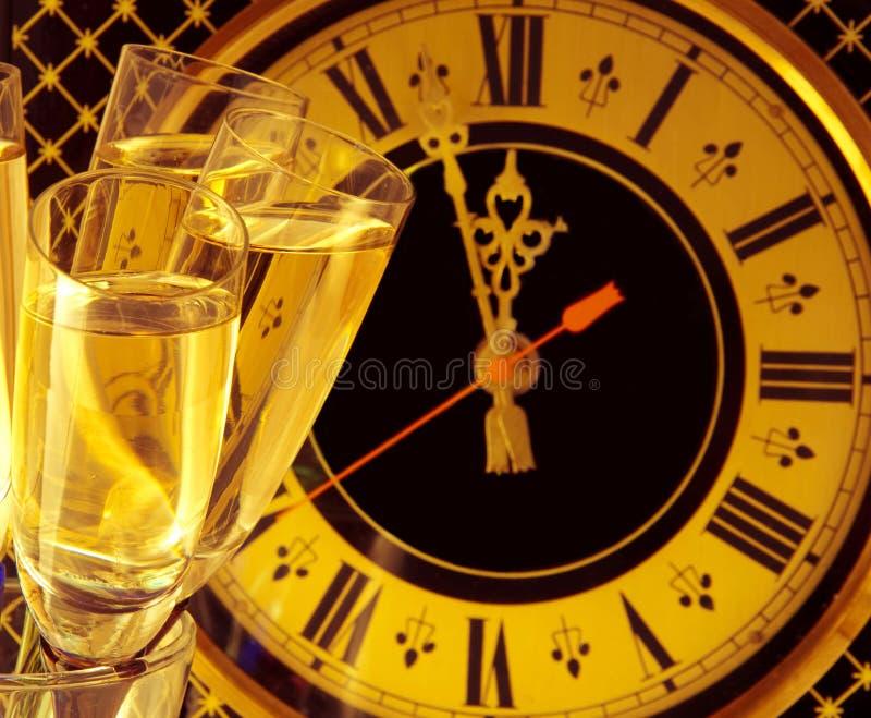 Glazen champagne op Nieuwjaar \ 's stock foto