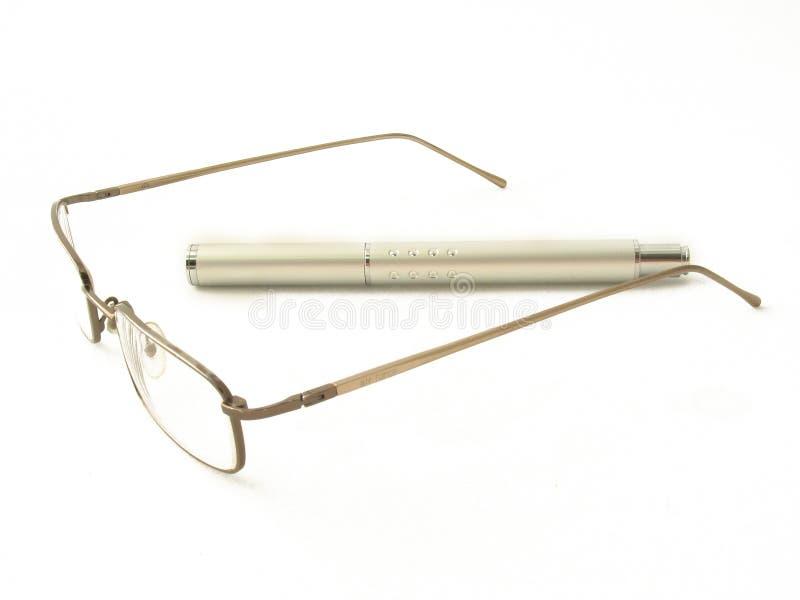 Glazen en pen stock afbeelding