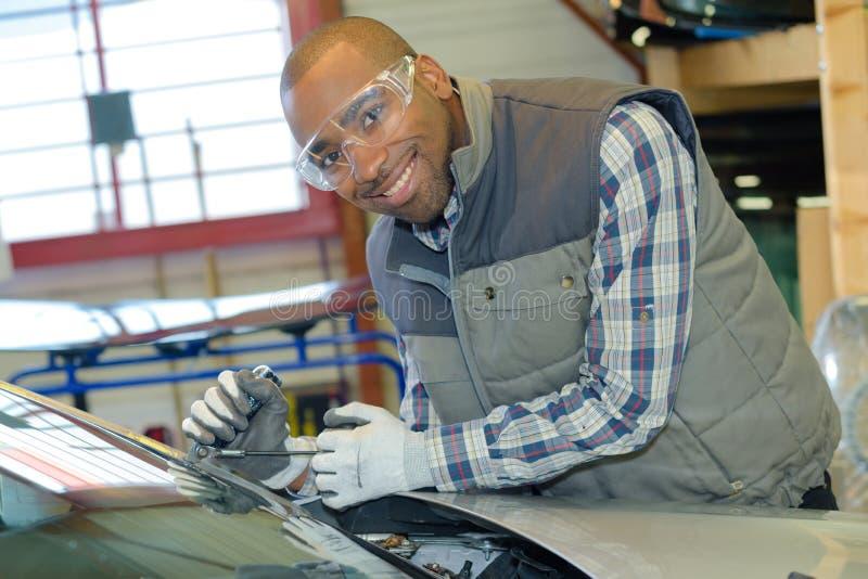 Glazier fixing car windshield. Glazier fixing the car windshield stock image