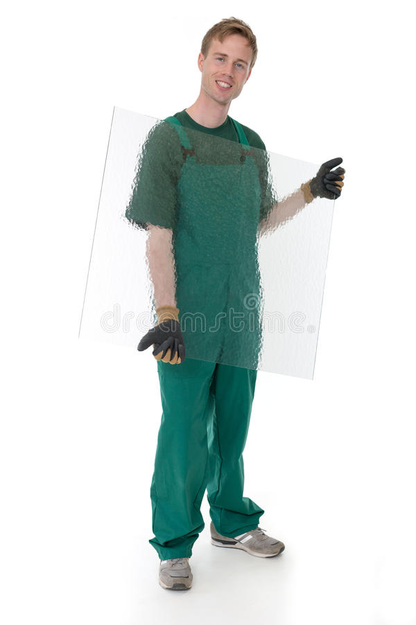 Glazier with pane of glass. Isolated in front of black background stock photos