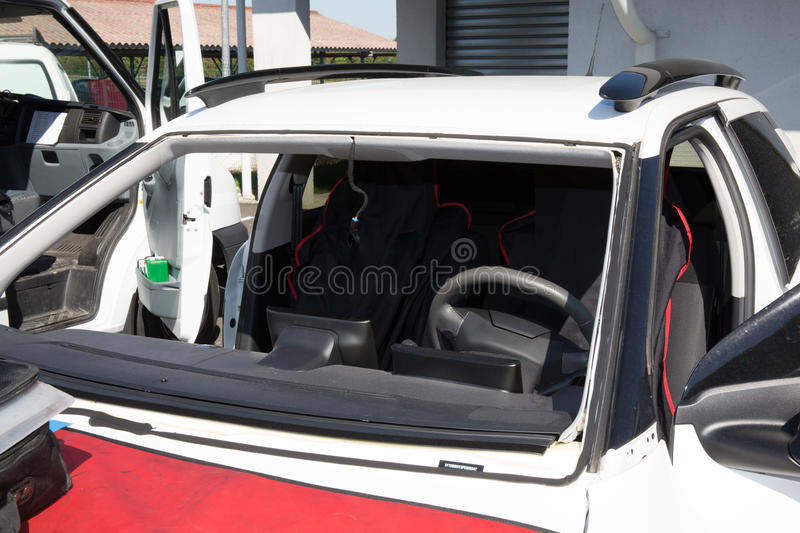 Glazier removing windshield or windscreen on a car stock photography