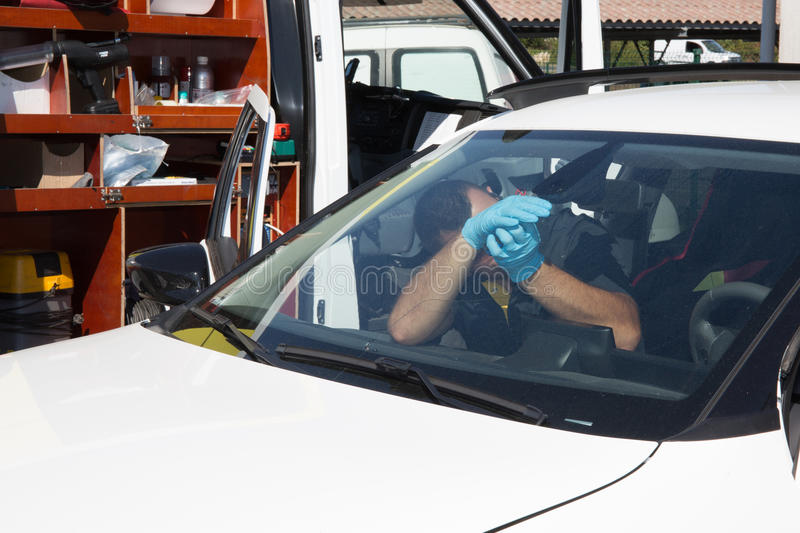 Glazier removing windshield or windscreen on a car royalty free stock photo