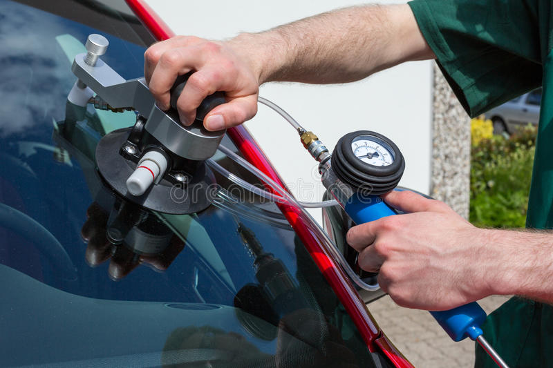 Glazier repairing windscreen after stone chipping damage stock photo
