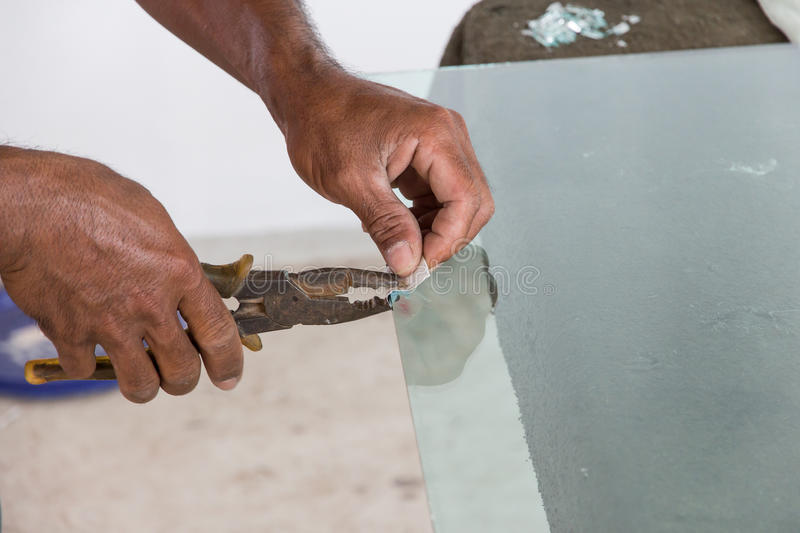 Glazier. Work installing glass in site construction royalty free stock photos
