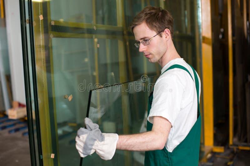 Glazier in workshop handling glass stock photos