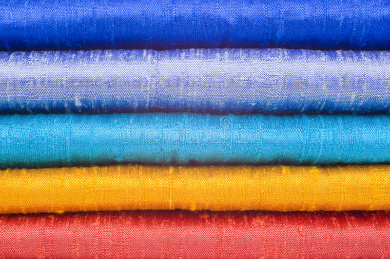 Gleaming Silk in Five Bright Colours. Bolts of brightly coloured silk in five bright colours royalty free stock images