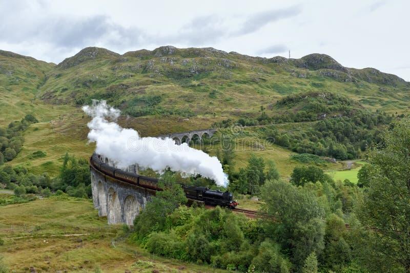 Gleanfinnan viaduct and steam train stock photo