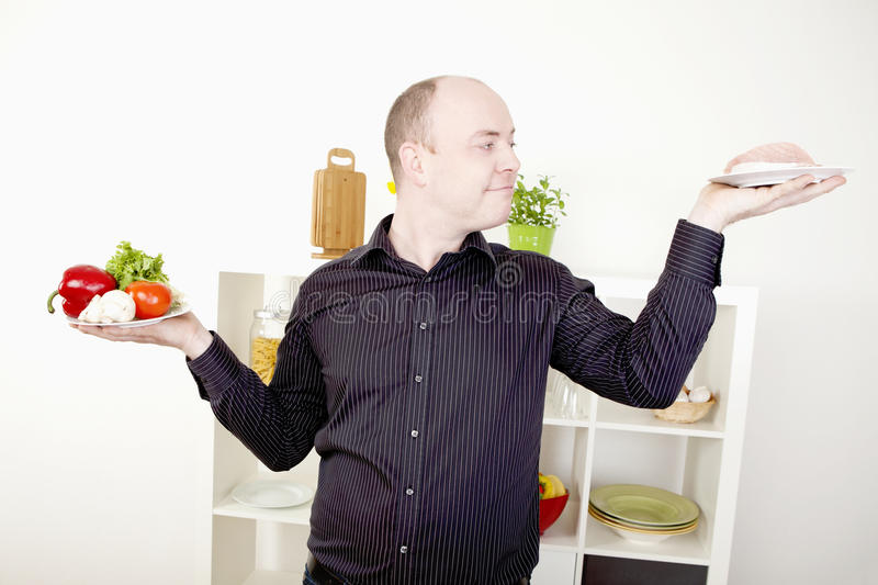 Man making a choice on food and diet stock image