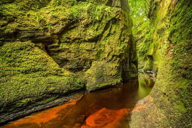 Glen Finnich in Scotland. Glen Finnich, Devil`s Pulit. Famous place near Glasgow stock photography