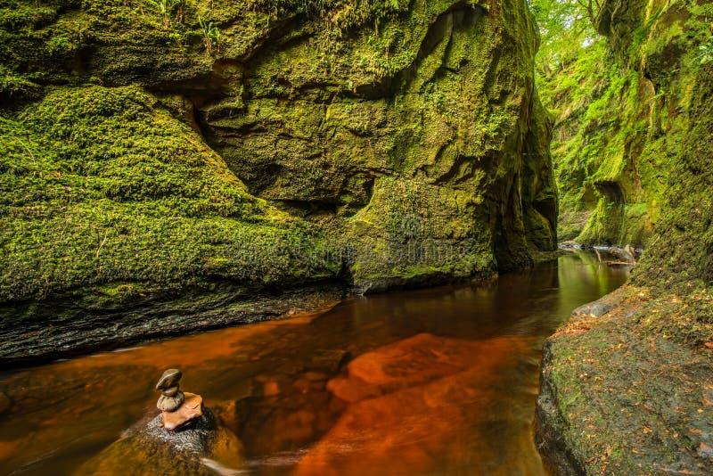 Glen Finnich in Scotland. Glen Finnich, Devil`s Pulit. Famous place near Glasgow stock photos