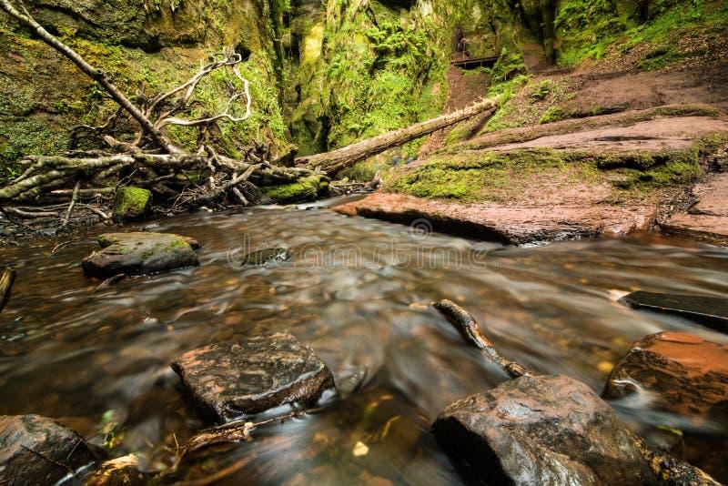 Glen Finnich in Scotland. Glen Finnich, Devil`s Pulit. Famous place near Glasgow royalty free stock image