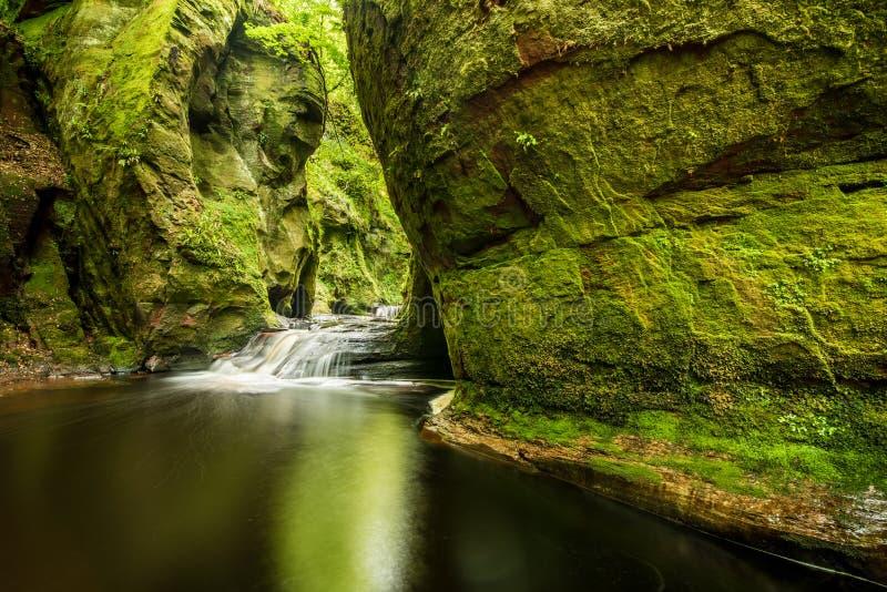 Glen Finnich in Scotland. Glen Finnich, Devil`s Pulit. Famous place near Glasgow royalty free stock photos