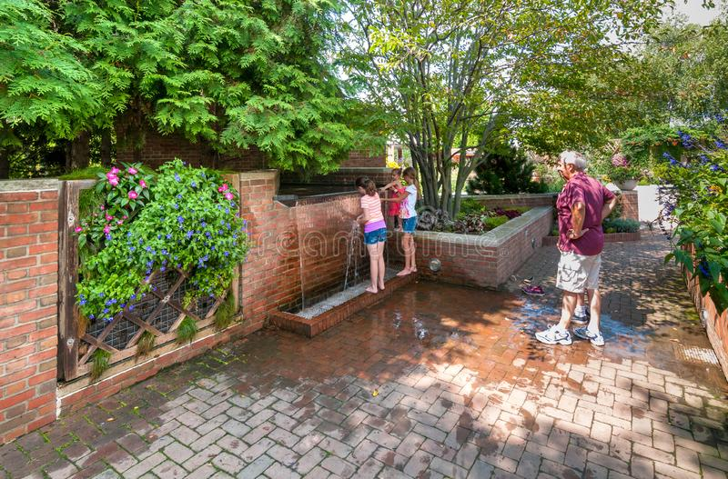People visiting the Chicago Botanic Garden, Glencoe, USA. Glencoe, Illinois, United States - August 20, 2014: People visiting the Chicago Botanic Garden, Glencoe royalty free stock image