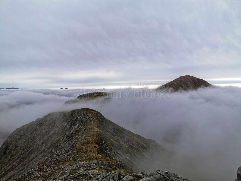 Glencoe Scotland Highlands mountains clouds summit royalty free stock photography