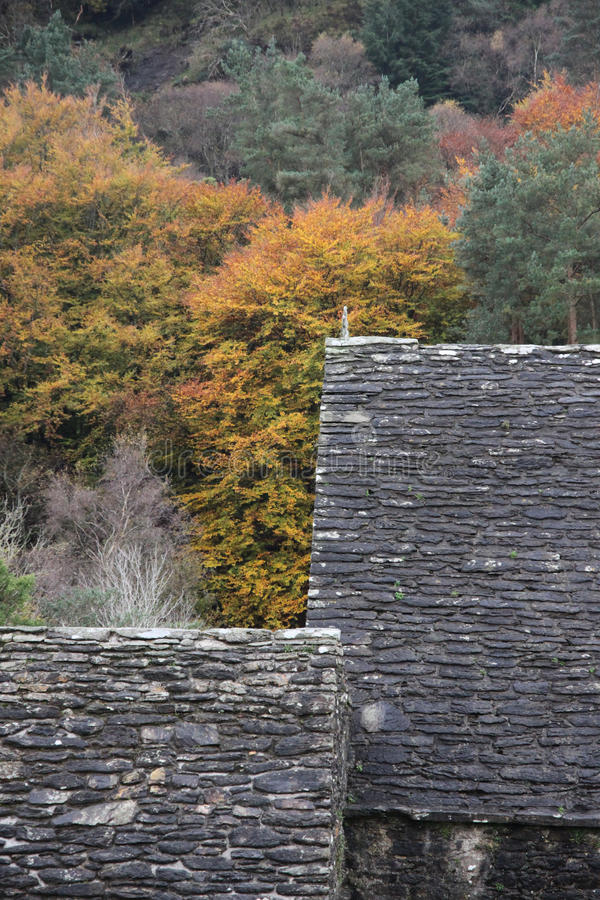 Glendalough roofs in the Wicklow Mountains National Park. Heavy slated roofs in Autumn royalty free stock photo