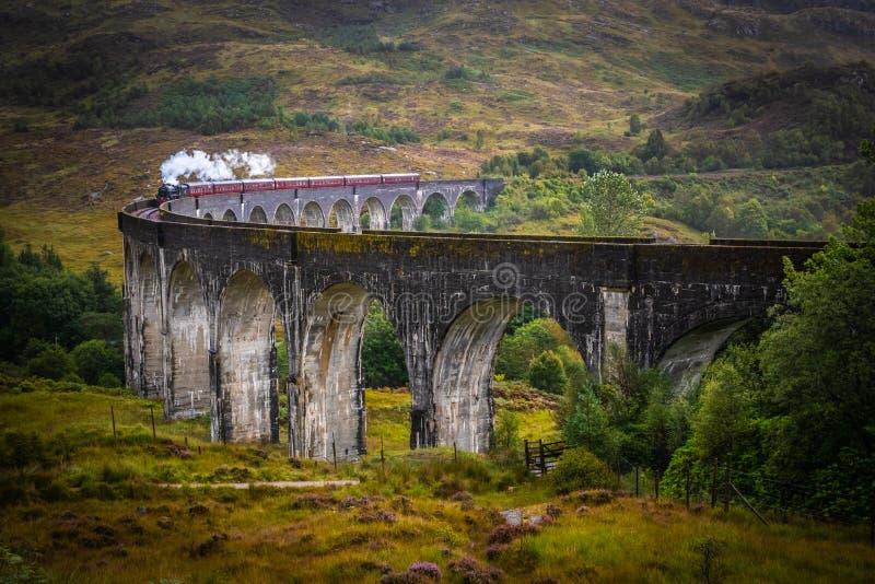 Glenfinnan Railway Viaduct with train stock photo