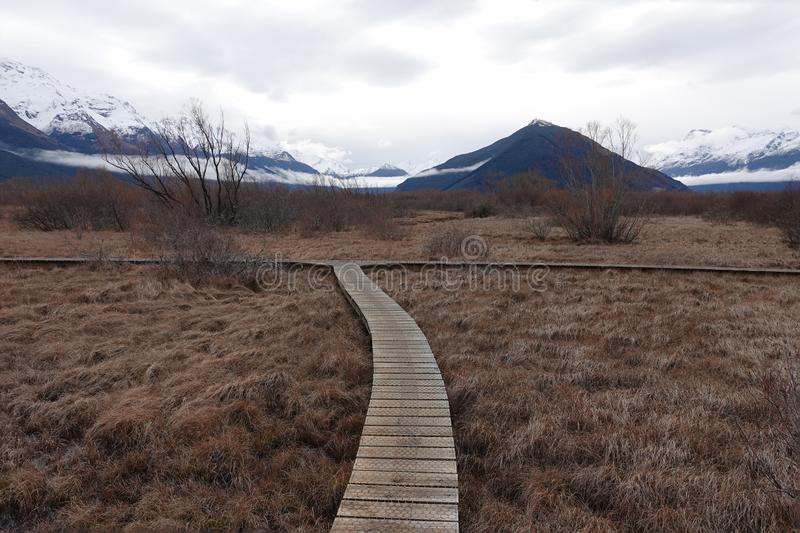 Glenorchy Lagoon Lake board walk in New Zealand. Right or left at `The Dead Marshes` in the Lord of The Rings trilogy on a winter day in Glenorchy on the South stock photos
