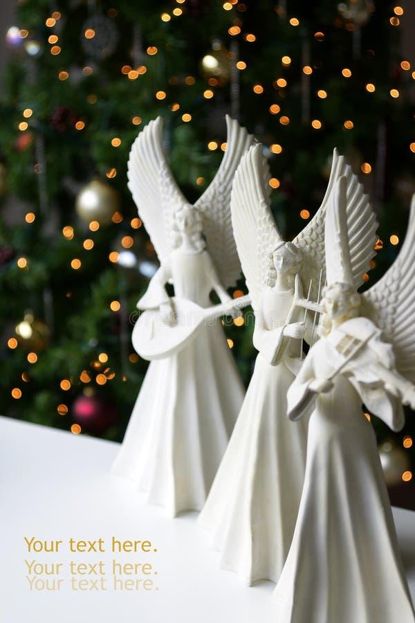Gli angeli di natale si dirigono l'interiore fotografia stock libera da diritti