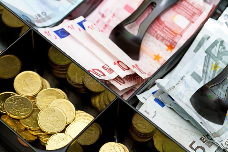 Gli euro soldi lavorano fotografie stock libere da diritti