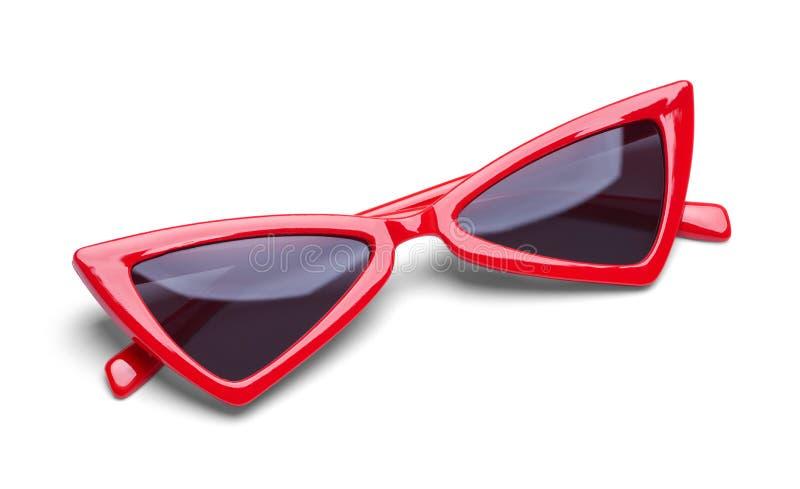 Gli occhiali da sole rossi hanno piegato immagini stock