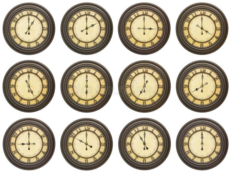 Gli orologi dell'annata 12 hanno isolato il collage bianco immagini stock