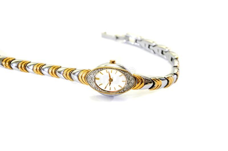 Gli orologi delle donne con il braccialetto su un fondo bianco fotografie stock libere da diritti