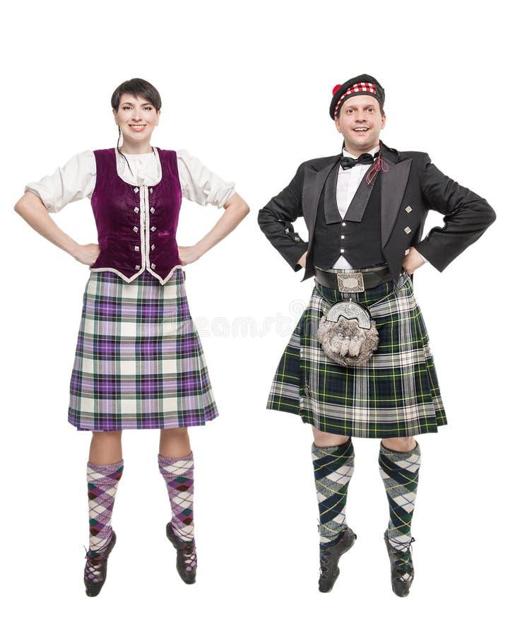 Gli Scottish ballanti della donna e dell'uomo di paia ballano immagini stock libere da diritti