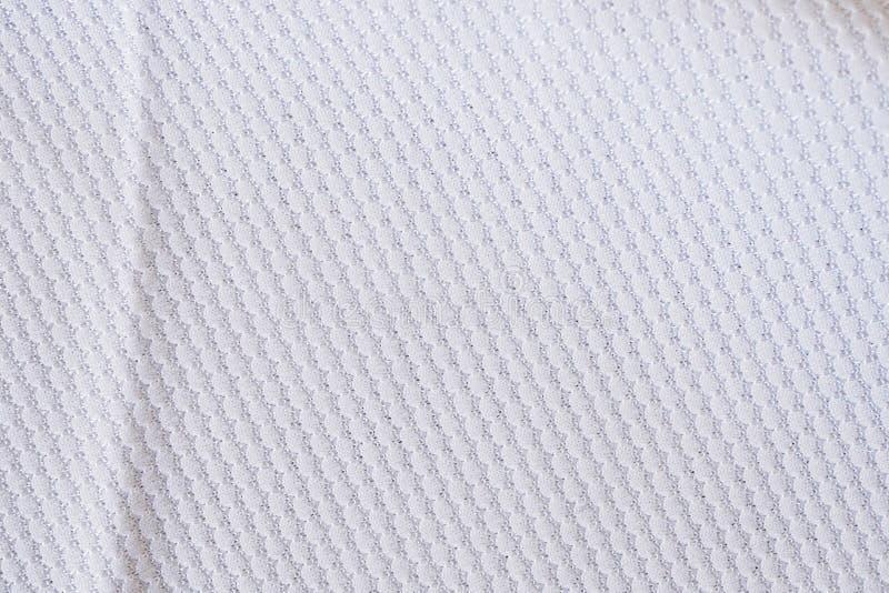 Gli sport bianchi di struttura del tessuto dell'abbigliamento del jersey di calcio durano immagine stock