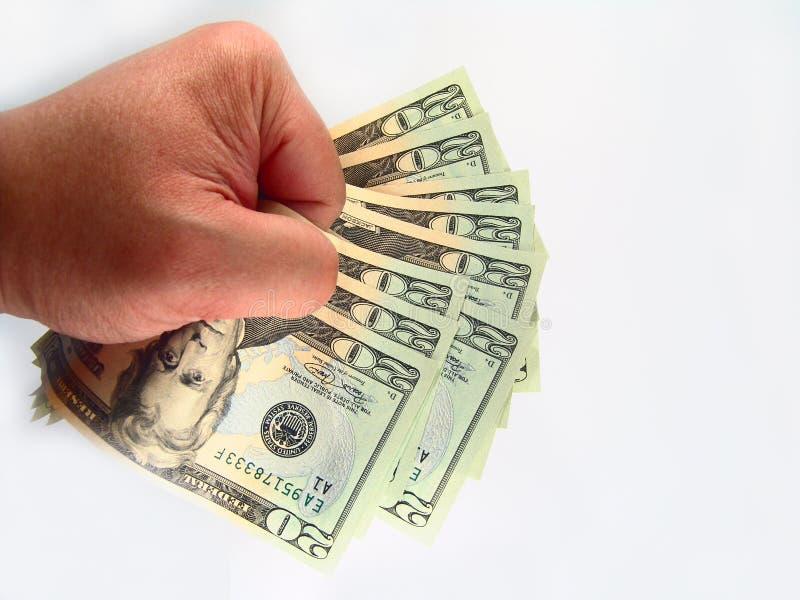 Gli Stati Uniti venti fatture & mano del dollaro fotografia stock