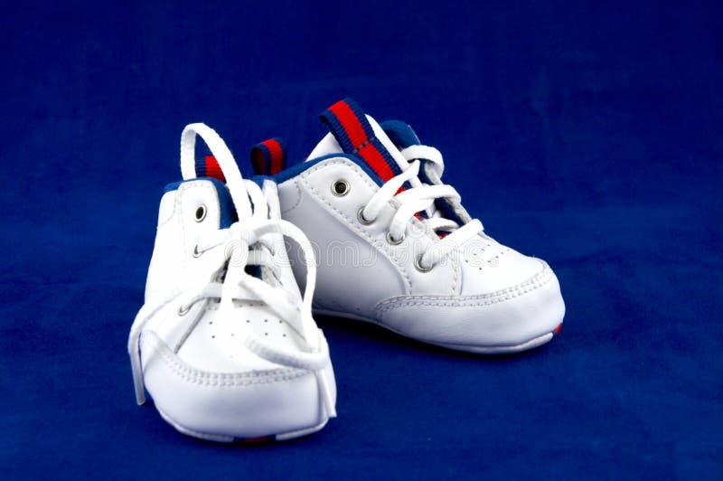 Gli stivali dei bambini fotografia stock
