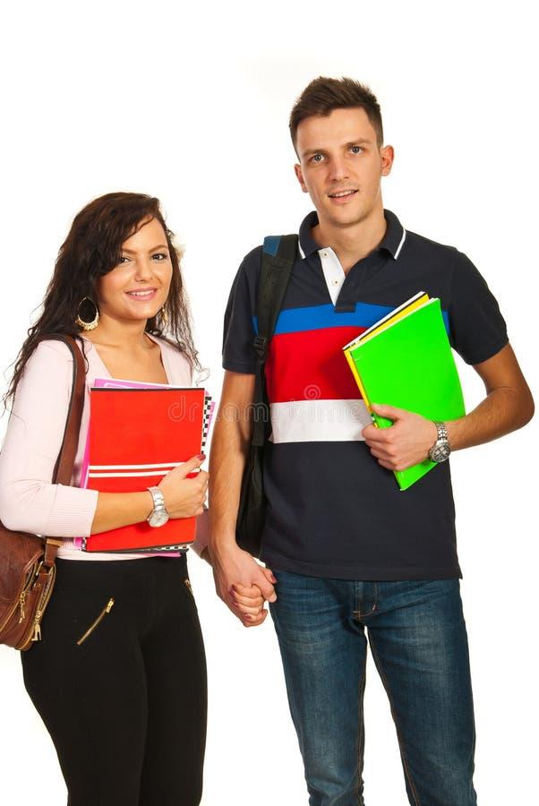 Gli studenti coppia andar a scuolae immagini stock