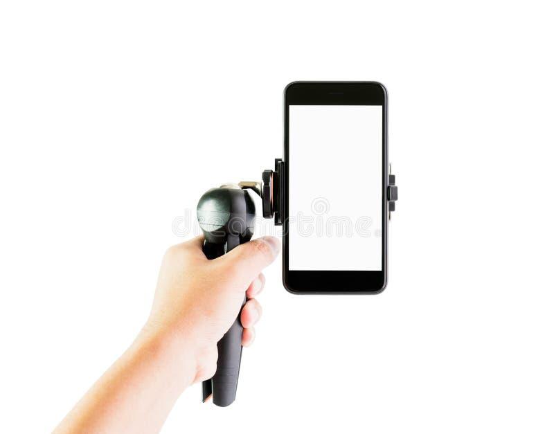 Gli uomini tengono l'attrezzatura per fare il telefono per ridurre la vibrazione Renda uno scorrevole alto e faccia video più fac fotografia stock libera da diritti